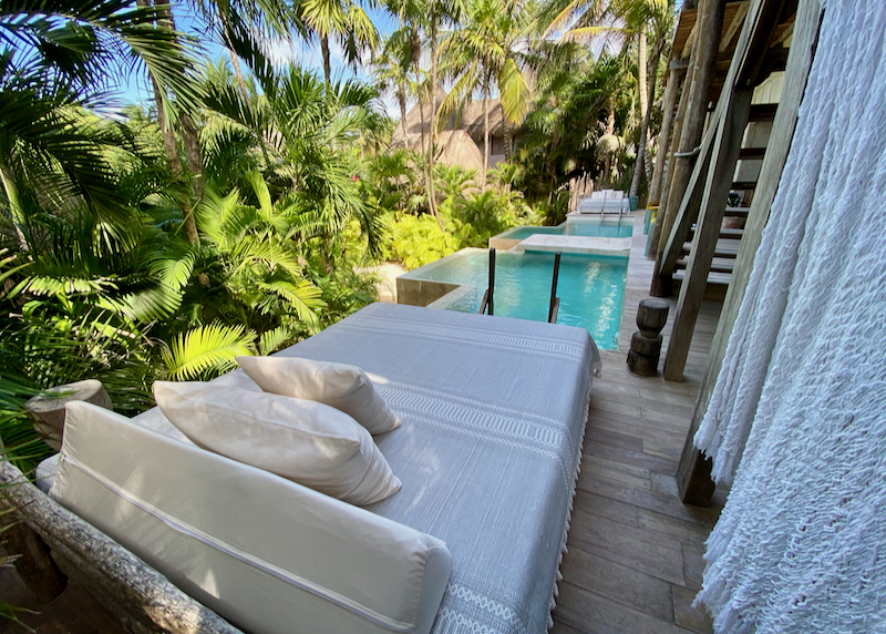 lounge bed by pool